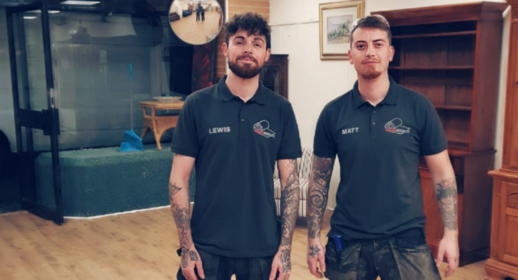 two flooring fitters standing